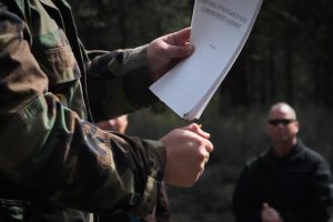 A Klamath Tribes descendant burns a copy of the UKBCA to symbolize disdain for the agreement.